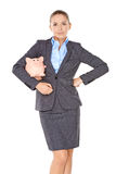 Businesswoman with a piggy bank Royalty Free Stock Image