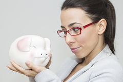 Businesswoman with piggy bank Stock Photos