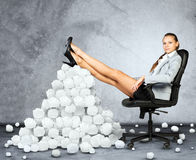 Businesswoman and pile crumpled paper balls Royalty Free Stock Photo