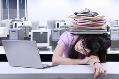 Businesswoman with a pile of paperwork Stock Images