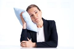 Businesswoman with pillow Royalty Free Stock Image