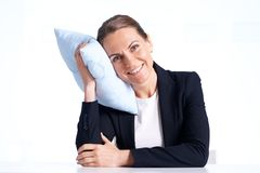 Businesswoman with pillow Royalty Free Stock Photography