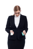 Businesswoman with pills Royalty Free Stock Photo