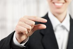 Businesswoman pinching finger sign Royalty Free Stock Photo