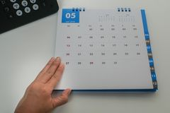 Businesswoman plan May 2018 calendar for remind meeting and appointment in office. Close up businesswoman plan May 2018 calendar for remind meeting and stock images