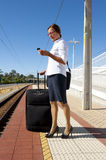 Businesswoman on platform at train station Royalty Free Stock Photo