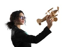 Businesswoman play with a toy aircraft. Concept of company startup and business success. Isolated on white background. Businesswoman play with a wooden toy royalty free stock photos