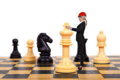 Businesswoman playing chess Stock Photo