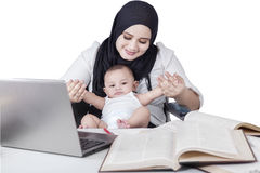 Businesswoman Playing with her Baby Stock Images