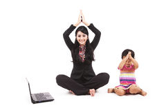 Businesswoman playing with her daughter Stock Photography