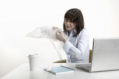 Businesswoman Playing With Plastic Bubble Wrap Stock Photography
