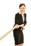 Businesswoman playing tug of war Stock Photography