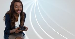 Free Businesswoman Playing With Computer Game Controller With Bright Curved Background Royalty Free Stock Images - 101765399