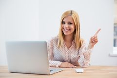 Businesswoman poing finger away Stock Photo