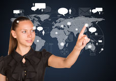 Businesswoman point finger at world map Stock Photo
