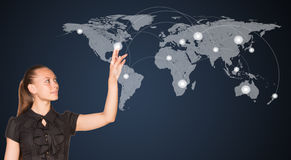 Businesswoman point finger at world map Stock Images