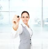 Businesswoman point pen camera, modern office Stock Photography