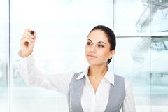Businesswoman point pen camera, modern office Royalty Free Stock Image