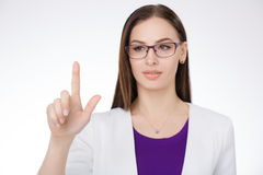 Businesswoman pointing against a white background Royalty Free Stock Images