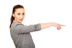 Businesswoman pointing aside. Stock Image