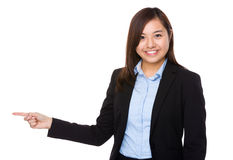 Businesswoman pointing aside for direction Stock Photos