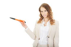 Businesswoman pointing aside with pen. Stock Image