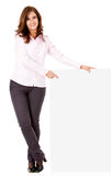 Businesswoman pointing at a banner Stock Photography