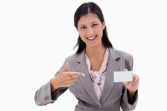 Businesswoman pointing at blank business card Stock Photography