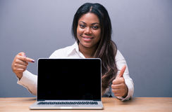 Businesswoman pointing on blank laptop screen Stock Photography