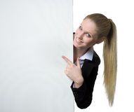 Businesswoman pointing at a blank sign next to her Royalty Free Stock Image