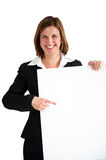 Businesswoman pointing blank white board isolated Stock Photos