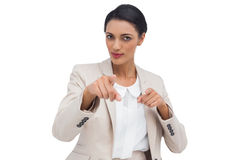 Businesswoman pointing at the camera. Against white background Royalty Free Stock Photo