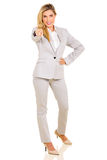 Businesswoman pointing at camera Stock Photo