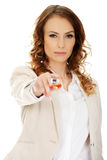 Businesswoman pointing on camera with pen. Stock Images