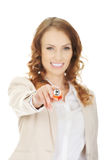 Businesswoman pointing on camera with pen. Royalty Free Stock Images