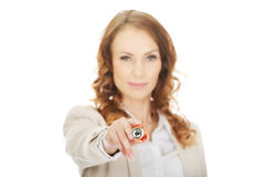 Businesswoman pointing on camera with pen. Stock Photo