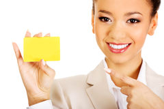 Businesswoman pointing on a card. Royalty Free Stock Photo