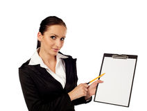 Businesswoman pointing on clipboard Stock Image