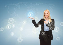 Businesswoman pointing at contact icons Royalty Free Stock Images