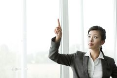Businesswoman Pointing at Copy-space Royalty Free Stock Image