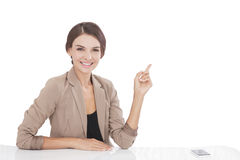 Businesswoman pointing at copy space isolated on Royalty Free Stock Photography