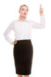 Businesswoman pointing at copy space pushing virtual button Royalty Free Stock Photo