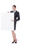 Businesswoman pointing on copyspace Royalty Free Stock Photos