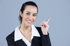 Businesswoman pointing at copyspace Stock Photography
