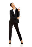 Businesswoman pointing at copyspace Stock Photos