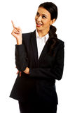 Businesswoman pointing at copyspace Royalty Free Stock Photo