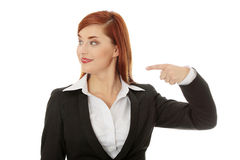 Businesswoman pointing direction Stock Image