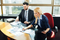 Businesswoman pointing at document during discussion at Stock Photos