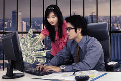 Businesswoman pointing dollar cash with her partner Royalty Free Stock Images