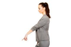 Businesswoman pointing down. Stock Photo